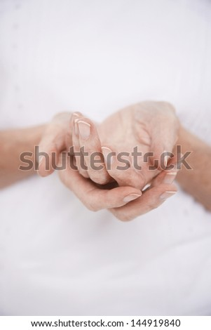 Closeup midsection of a woman cupping her hands - stock photo
