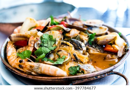 closeup mix seafood soup pot.