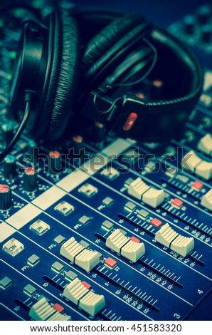 Closeup mixer with Earphone background, music instrument concept - stock photo