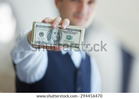 closeup money in male hands - stock photo