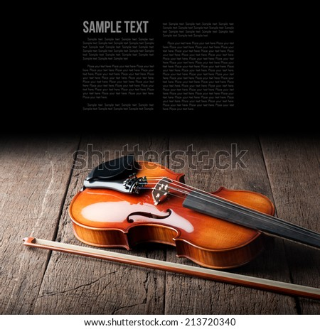 closeup new classical violin on wooden background - stock photo