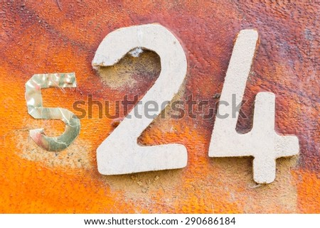 closeup number 24 on red wooden sign board in thailand