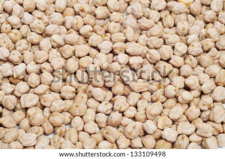 closeup of a a pile of dried chickpeas - stock photo