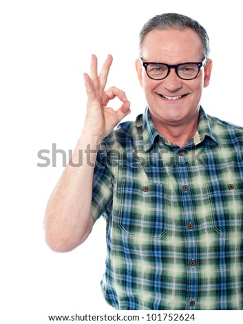 Closeup of a aged man gesturing an excellent job done sign. Smiling - stock photo