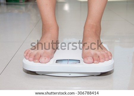 Closeup of a Asians weighed - stock photo