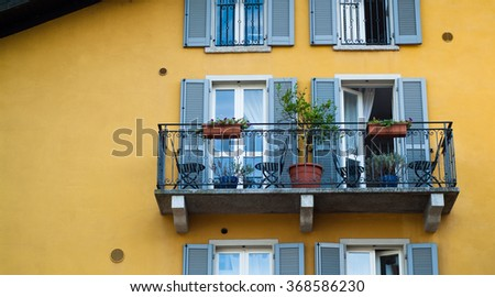closeup of a balcony on a yellow house in Italy