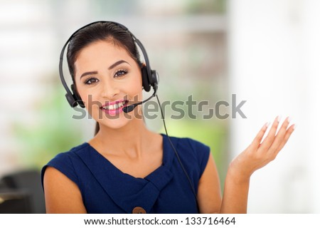 Closeup of a beautiful business customer service woman smiling - stock photo
