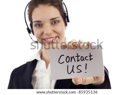 Closeup of a beautiful customer service woman holding a card- Contact Us! isolated on white background