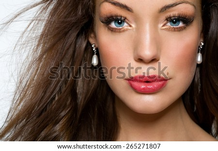 Closeup of a beautiful girl with blue eyes.