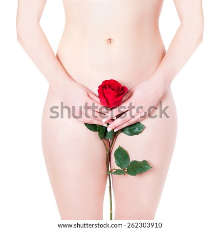 Closeup of a beautiful nude woman hiding her pubic region with a red rose, beauty concept , isolated front of white studio background - stock photo