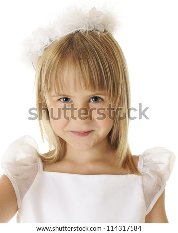 "Closeup of a beautiful shy ""angel"" dressed all in white.  On a white background."
