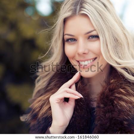 Closeup of a beautiful smiling woman  - stock photo