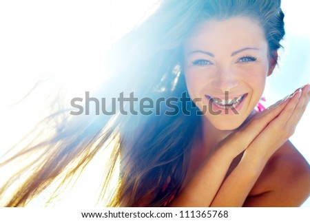 Closeup of a beautiful smiling young woman - stock photo