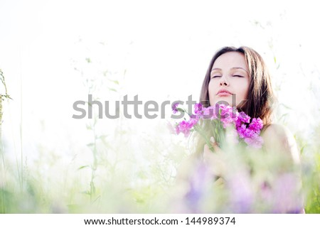 Closeup of a beautiful smiling young woman - stock photo