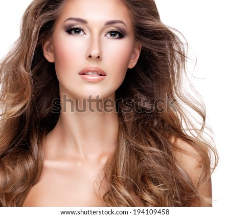 Closeup of a beautiful woman with long brown hair, isolated on white - stock photo