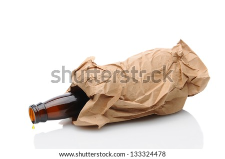 Closeup of a beer bottle inside a brown paper bag laying on its side with a drip on the lip of the container. Isolated on white with reflection. - stock photo