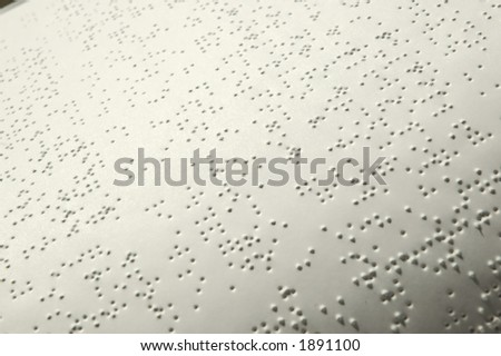 Closeup of a Bible written in Braille - stock photo