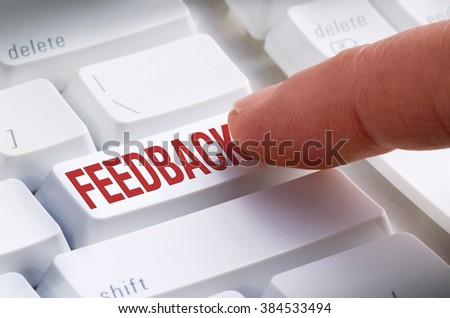 Closeup of a big FEEDBACK button on a keyboard with a finger getting ready to hit it and make a online feedback submission.