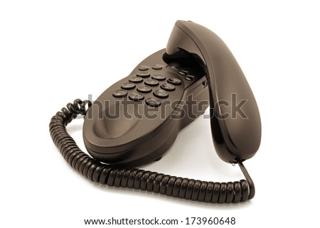 Closeup of a black corded telephone against a white background - stock photo
