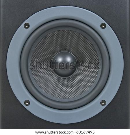 Closeup of a black professional loud speaker. - stock photo