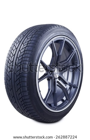 Closeup of a black tire textured with a racing rim, isolated on white background - stock photo