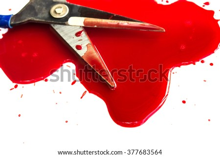 closeup of a bloody scissors on a white background