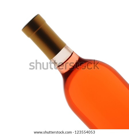 Closeup of a blush wine bottle over a white background. Bottle is at a 45 degree angle only showing the top half of the container.