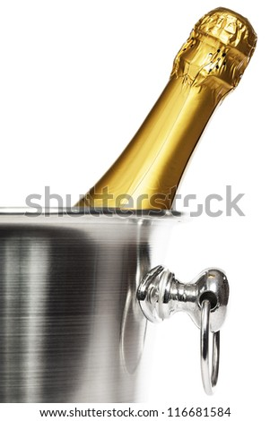 closeup of a bottle of champagne in a champagne bucket on white background - stock photo