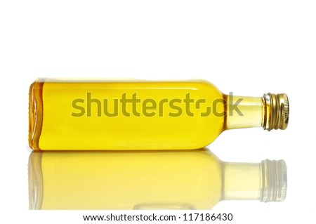closeup of a bottle of olive oil on a white background - stock photo
