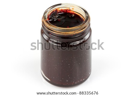 Closeup of a bottle of Thai spicy Chili Paste in oil, Chili Jam, Naam Prik Pao isolated on white background. It is the main ingredient to make tom yum goong hot soup