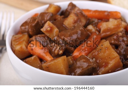 Closeup of a bowl of beef stew - stock photo