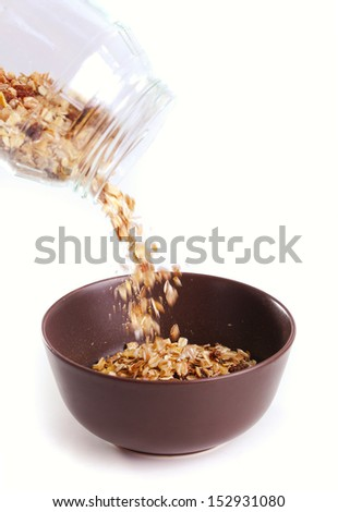 Closeup of a bowl pouring with muesli