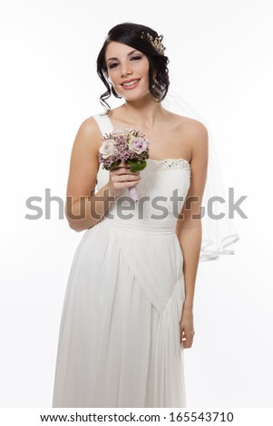 Closeup of a bride with flowers - stock photo