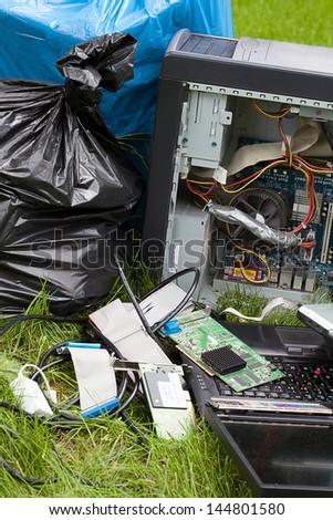 Closeup of a broken electronics on a grass - stock photo
