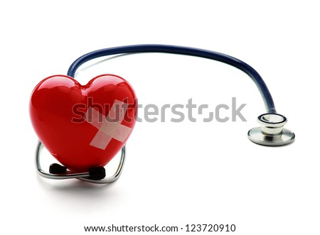 Closeup of a broken heart with a stethoscope, isolated on white background - stock photo