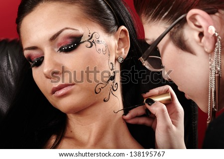 Face tattoo stock images royalty free images vectors for Face tattoo makeup