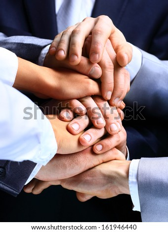 Closeup Of A Business Colleagues With Their Hands Stacked - stock photo