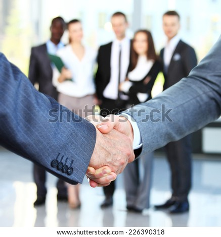 Closeup of a business handshake. Business people shaking hands, finishing up a meeting  - stock photo