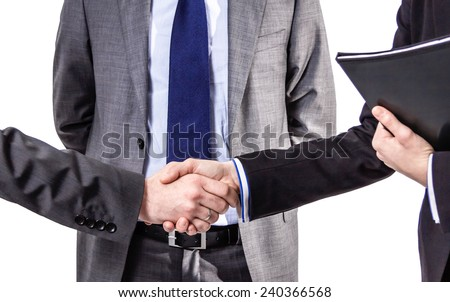 Closeup of a business handshake for closing deal isolated on white background - stock photo