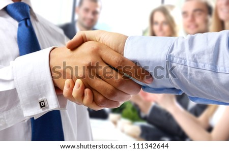 Closeup of a business handshake, isolated on white - stock photo