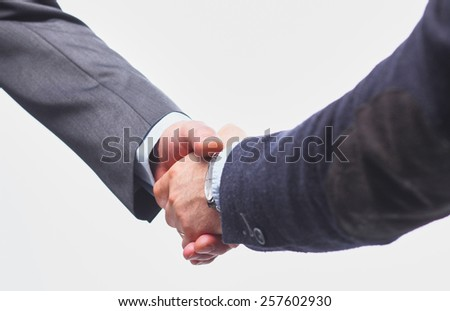 Closeup of a business handshake, on white background - stock photo