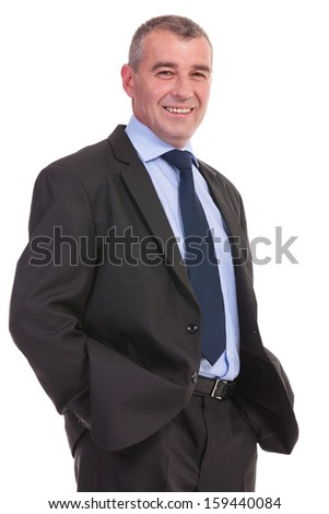 closeup of a business man smiling for the camera with his hands in his pockets. on a white background