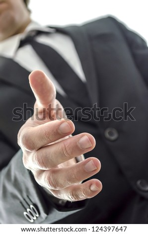 Closeup of a businessman offering a handshake.