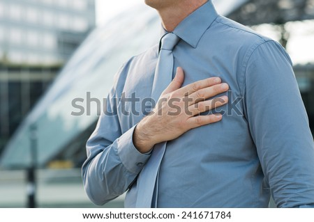 Closeup Of A Businessman With Hand On His Chest Outdoor - stock photo