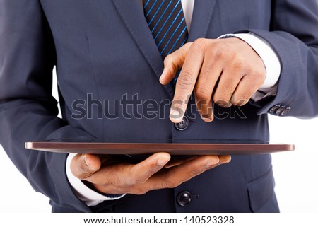 Closeup of a businessman working with a digital tablet, isolated on white background - stock photo