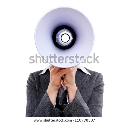 Closeup of a businesswoman hiding face behind  the  megaphone against a white background