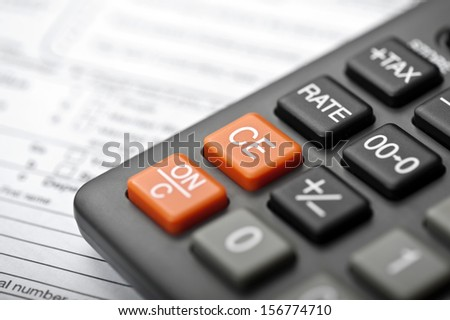 Closeup of a Calculator and tax form - stock photo