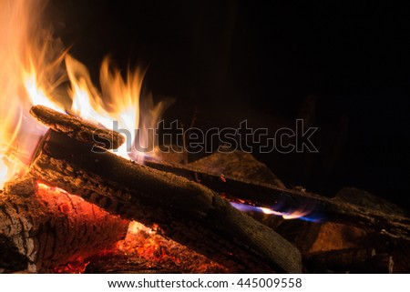 Closeup of a campfire on a summer night - stock photo