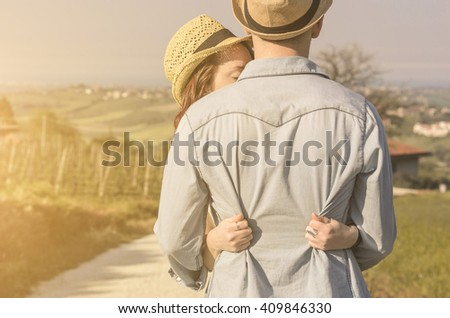 closeup of a caucasian couple lovers embracing in a countryside - lifestyle,people,outdoor and mood concept - stock photo