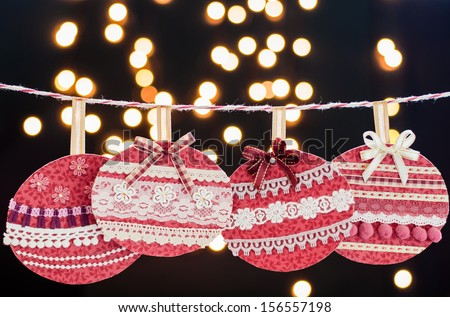 Closeup of a Christmas decoration hanging with blurry Christmas lights. - stock photo